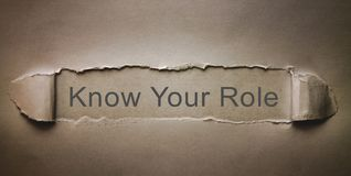 Ξέρτε το ρόλο σας σε σχισμένο χαρτί στοκ φωτογραφίες