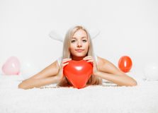 Ξανθή γυναίκα με τα μπαλόνια Στοκ Εικόνα