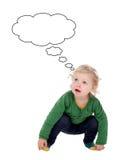 Ξανθό μωρό που σκέφτεται κάτι Στοκ εικόνα με δικαίωμα ελεύθερης χρήσης