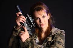ξανθό πυροβόλο όπλο Στοκ Εικόνες