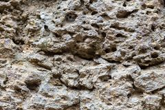 Ξεπερασμένη φωτογραφία σύστασης πετρών φυσική πέτρα ανασκόπησης Πορώδης ανακούφιση βράχου Παλαιός τοίχος πετρών κτηρίου Στοκ εικόνες με δικαίωμα ελεύθερης χρήσης