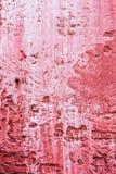 Ξεπερασμένος κόκκινος τοίχος ασβεστοκονιάματος με το στάλαγμα χρωμάτων στοκ εικόνες