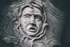 Ξεπερασμένος μορφασμός λεπτομέρειας αγαλμάτων πετρών Στοκ Εικόνες