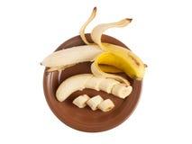 Ξεφλουδισμένη μπανάνα στο πιάτο Στοκ εικόνες με δικαίωμα ελεύθερης χρήσης