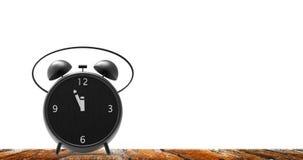 Ξυπνητήρι με τα μικρά πρακτικά στο ρολόι δώδεκα ο ` Στοκ εικόνα με δικαίωμα ελεύθερης χρήσης