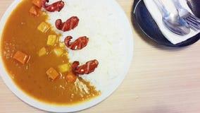 Ξυστρισμένα ρύζι και χοτ-ντογκ Στοκ Εικόνα