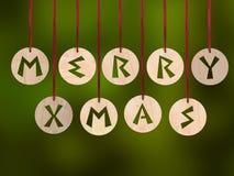 Ξύλινες μπούκλες με το αποκόπτω εύθυμο χαιρετισμό Χριστουγέννων στοκ φωτογραφία