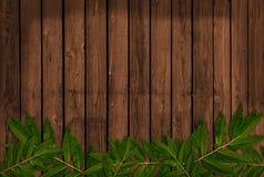 Ξύλινη ανασκόπηση με τα φύλλα Στοκ Εικόνα