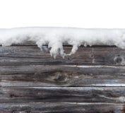 Ξύλινη επιτραπέζια γέφυρα που καλύπτεται το παγωμένο χιόνι που απομονώνεται με στο λευκό Στοκ Εικόνα
