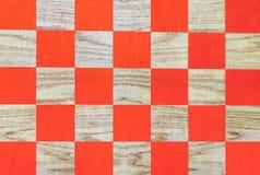 Ξύλινη σκακιέρα με τα πορτοκαλιά κύτταρα checkerboard ανασκόπησης παραγμένη υπολογιστής όψη προοπτικής εικόνας στοκ φωτογραφίες
