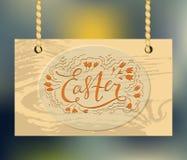 Ξύλινο κείμενο ευτυχές Πάσχα σημαδιών και χαιρετισμού επίσης corel σύρετε το διάνυσμα απεικόνισης γράψιμο προτύπων σημειωματάριων Διανυσματική απεικόνιση