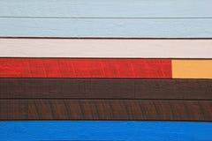 Ξύλινο να πλαισιώσει χρωμάτισε στα φωτεινά χρώματα καφετιού, μπλε, κίτρινος, του μαυρίσματος και καφετής Στοκ Εικόνες