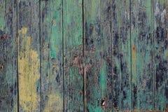 Ξύλινο υπόβαθρο πορτών, ζωηρόχρωμος και ξεφλουδισμένος Η ηλικίας είσοδος, κλείνει επάνω την άποψη με τις λεπτομέρειες Στοκ Φωτογραφίες