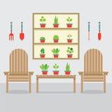 Ξύλινα έδρες κήπων και φυτά γλαστρών Στοκ εικόνα με δικαίωμα ελεύθερης χρήσης