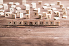 Ξύλινα στοιχεία με συλλεχθε'ν το επιστολή playschool λέξης Στοκ Εικόνα