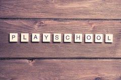 Ξύλινα στοιχεία με συλλεχθε'ν το επιστολή playschool λέξης Στοκ Φωτογραφίες