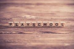 Ξύλινα στοιχεία με συλλεχθε'ν το επιστολή playschool λέξης Στοκ φωτογραφία με δικαίωμα ελεύθερης χρήσης