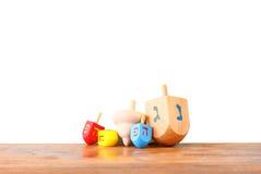 Ξύλινα dreidels για το hanukkah που απομονώνεται στο άσπρο υπόβαθρο Στοκ Φωτογραφίες