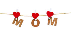 Ξύλινες επιστολές και καρδιά που διαμορφώνουν mom Στοκ Φωτογραφία