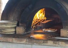 Ξύλινη έννοια μαγειρέματος σάλτσας πυρκαγιάς εγκαυμάτων πυρκαγιάς πιτσών Στοκ Εικόνες