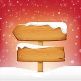 Ξύλινοι κενοί πίνακας σημαδιών και χειμερινό χιόνι με το διάστημα αντιγράφων Στοκ Εικόνες