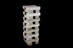 Ξύλινοι φραγμοί παιχνιδιού που συσσωρεύονται σε ένα μαύρο κλίμα Στοκ φωτογραφίες με δικαίωμα ελεύθερης χρήσης
