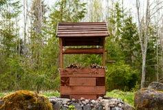 Ξύλινος καλά στα ξύλα Στοκ Φωτογραφίες