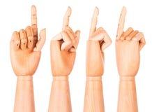 Ξύλινο δάχτυλο που δείχνει ή σχετικά με Στοκ εικόνες με δικαίωμα ελεύθερης χρήσης
