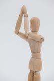 Ξύλινο ειδώλιο που στέκεται και με τα δύο χέρια που ενώνονται Στοκ Εικόνες