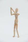 Ξύλινο ειδώλιο που στέκεται και με τα δύο χέρια που ενώνονται Στοκ Εικόνα