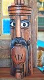 Ξύλινο κεφάλι με έναν σωλήνα Στοκ Εικόνες
