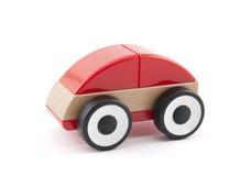Ξύλινο κόκκινο παιχνίδι αυτοκινήτων Στοκ εικόνα με δικαίωμα ελεύθερης χρήσης