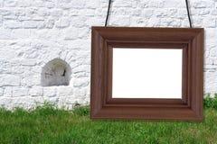 Ξύλινο πλαίσιο στο υπόβαθρο των έπαλξεων Στοκ φωτογραφία με δικαίωμα ελεύθερης χρήσης