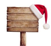 Ξύλινο σημάδι με το καπέλο κόκκινου Santa Στοκ Φωτογραφίες