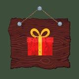 Ξύλινο σημάδι με το δώρο Στοκ εικόνα με δικαίωμα ελεύθερης χρήσης
