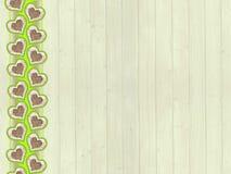 Ξύλινο υπόβαθρο με τα σύνορα σχεδίων καρδιών Στοκ Εικόνα
