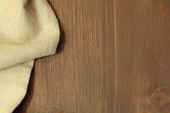 Ξύλινο υπόβαθρο με το λινό Στοκ φωτογραφία με δικαίωμα ελεύθερης χρήσης