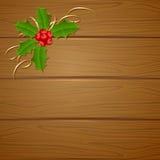 Ξύλινο υπόβαθρο Χριστουγέννων με το μούρο ελαιόπρινου Στοκ φωτογραφία με δικαίωμα ελεύθερης χρήσης