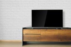 Οδηγημένη TV στη στάση TV στο κενό δωμάτιο με τον άσπρο τουβλότοιχο διακοσμήστε στοκ εικόνες