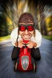 Οδηγός στο αγωνιστικό αυτοκίνητο παιχνιδιών Στοκ εικόνες με δικαίωμα ελεύθερης χρήσης