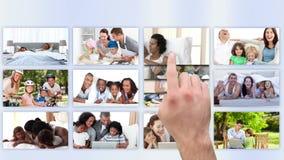 Οθόνη αφής που χρησιμοποιείται για να προσέξει τις οικογενειακές ταινίες απόθεμα βίντεο