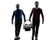 Οικογένεια ατόμων γονέων ομοφυλοφίλων με τη σκιαγραφία μωρών Στοκ Εικόνες