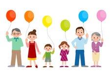 Οικογένειες με τα μπαλόνια Στοκ Φωτογραφίες