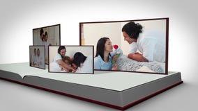 Οικογενειακά βίντεο σε ένα βιβλίο σε ένα άσπρο κλίμα απόθεμα βίντεο