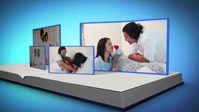 Οικογενειακά βίντεο σε ένα βιβλίο σε ένα μπλε κλίμα απόθεμα βίντεο