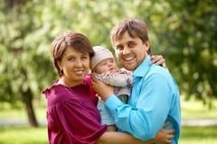 οικογενειακά πρόσωπα τρί& Στοκ Φωτογραφίες