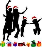 οικογενειακές σκιαγραφίες Χριστουγέννων Στοκ Φωτογραφίες