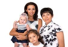 οικογενειακό ευτυχές & παραγωγή τρία απομονωμένος στοκ φωτογραφία