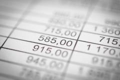 Οικονομικοί αριθμοί σε μια κινηματογράφηση σε πρώτο πλάνο αφαίρεση Στοκ Εικόνα