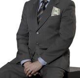 Οικονομικός ανώτερος υπάλληλος με το λογαριασμό δολαρίων που απομονώνεται στο λευκό Στοκ Εικόνες